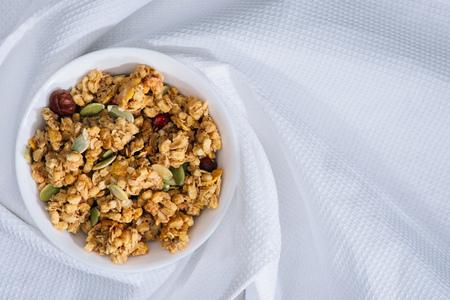 Foto de plate with homemade granola on white tablecloth - Imagen libre de derechos