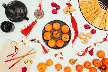 Photo pour various chinese talimans with tangerines and tea isolated on white, Chinese New Year concept - image libre de droit