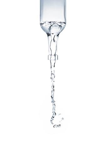 Photo pour water pouring from glass bottle - image libre de droit