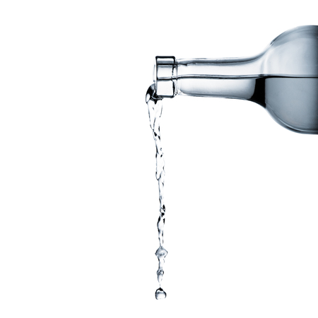 Photo for water pouring from glass bottle - Royalty Free Image