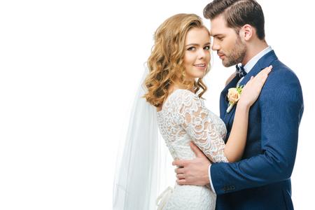 Foto de sensual bride and groom isolated on white - Imagen libre de derechos