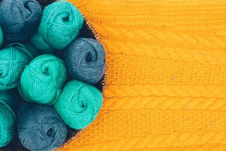 Foto de warm yarn balls in wicker basket - Imagen libre de derechos