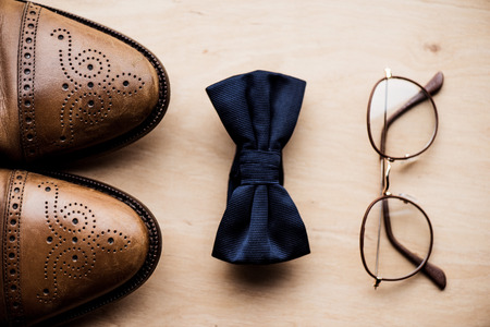 Photo for shoes, tie bow and glasses on wooden surface - Royalty Free Image