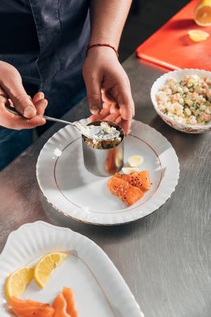 Photo pour chef preparing salad with metal forming tube at restaurant - image libre de droit