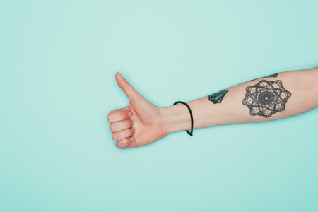 Photo for Cropped shot of woman showing thumb up - Royalty Free Image