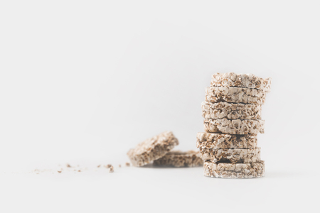 Photo pour stack of healthy rice cakes isolated on white - image libre de droit