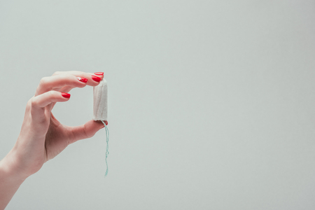 Photo pour cropped shot of woman holding tampon in hand - image libre de droit
