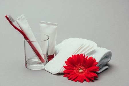 Photo pour hygiene supplies, flower and towel isolated on grey - image libre de droit