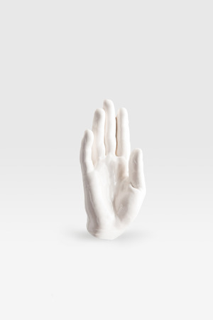 Photo for abstract sculpture in shape of human arm in white paint - Royalty Free Image