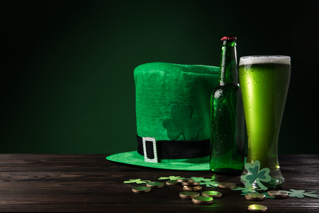 Photo for green hat with green beer and coins on wooden table, st patricks day concept - Royalty Free Image