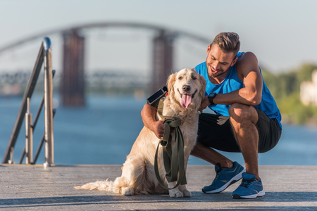 Photo for sportswoman with dog on quay - Royalty Free Image