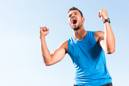 Foto per sportsman celebrating triumph - Immagine Royalty Free