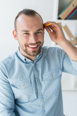 Photo for man with pencil behind ear - Royalty Free Image