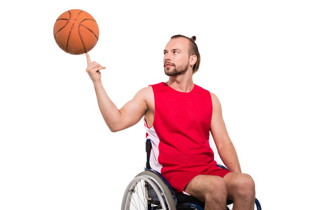 Photo pour sportsman in wheelchair playing with basketball - image libre de droit