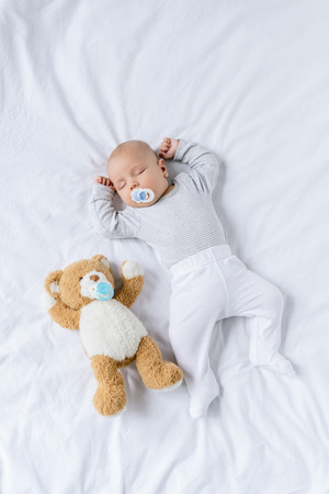 Photo pour baby sleeping with toy - image libre de droit