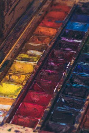Photo for close-up view of watercolor paints in messy container  - Royalty Free Image
