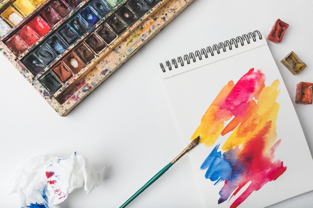 Photo for top view of watercolor paints and paintbrush at designer workplace - Royalty Free Image