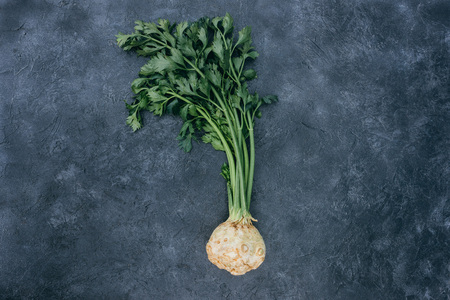 Photo for top view of healthy celery with root on black - Royalty Free Image