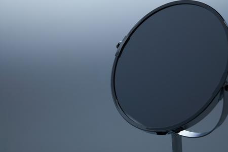 Photo pour close-up shot of makeup mirror with stand on grey - image libre de droit