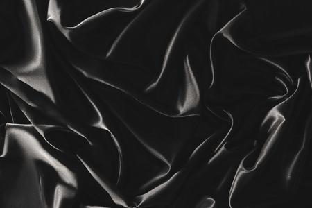Photo pour full frame of black elegant silk cloth as background - image libre de droit