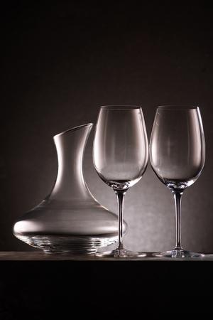 Foto de still life of empty decanter and wineglasses on black - Imagen libre de derechos