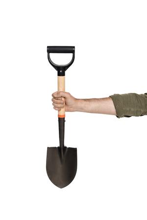 Foto de partial view of man holding shovel in hand isolated on white - Imagen libre de derechos