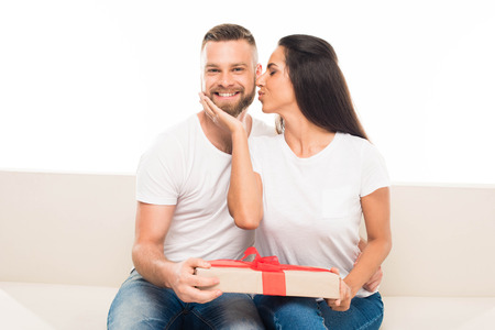 Photo for 'portrait of young attractive couple with gift box, isolated on white - Royalty Free Image