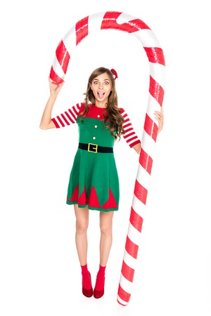 Photo for grimace woman in elf costume holding decorative Christmas lollipop isolated on white - Royalty Free Image
