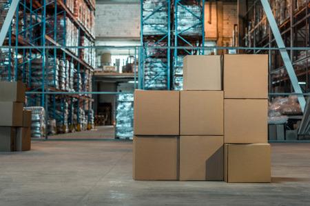 Photo pour cardboard boxes in modern warehouse interior  - image libre de droit