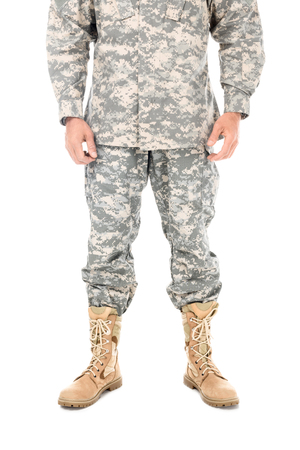 Foto de partial view of soldier in military uniform isolated on white - Imagen libre de derechos