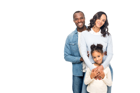Photo pour beautiful happy african american family smiling at camera isolated on white - image libre de droit