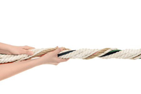 Photo pour close-up partial view of human hands holding twisted ropes isolated on white - image libre de droit