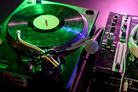Photo for sound mixer, microphone and vinyl in nightclub with back light - Royalty Free Image