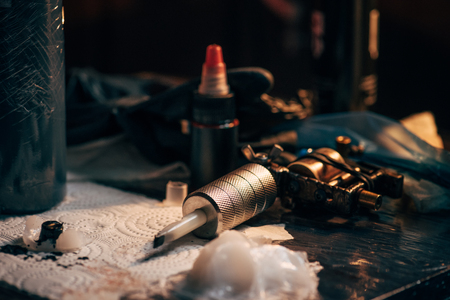 Photo pour close up view of tattoo machine, ink and other equipment for tattooing process - image libre de droit