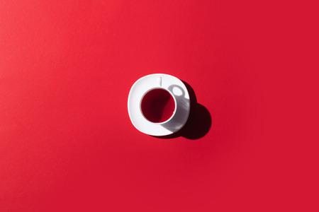 Foto de top view of cup of herbal tea isolated on red - Imagen libre de derechos
