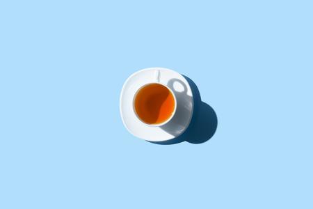 Foto de top view of cup of healthy herbal tea isolated on blue - Imagen libre de derechos