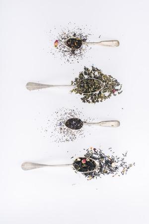 Foto de top view of healthy aromatic herbal tea and spoons on grey - Imagen libre de derechos