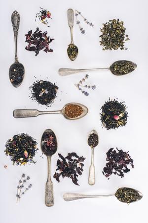 Foto de top view of assorted herbal tea and spoons on grey - Imagen libre de derechos