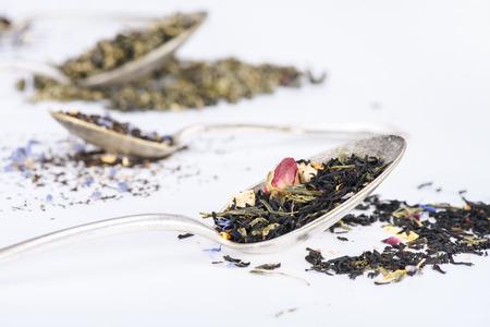 Foto de close-up view of aromatic organic herbal tea and spoons on grey - Imagen libre de derechos