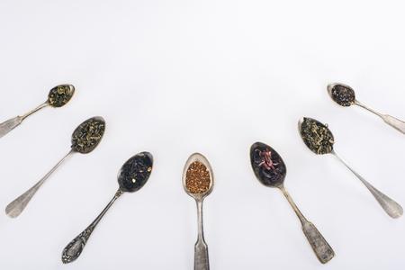 Foto de top view of assorted organic herbal tea in spoons isolated on grey - Imagen libre de derechos