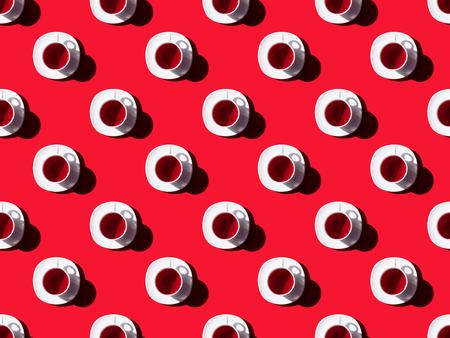 Foto de top view of seamless pattern with healthy tea in cups and shadows on red - Imagen libre de derechos