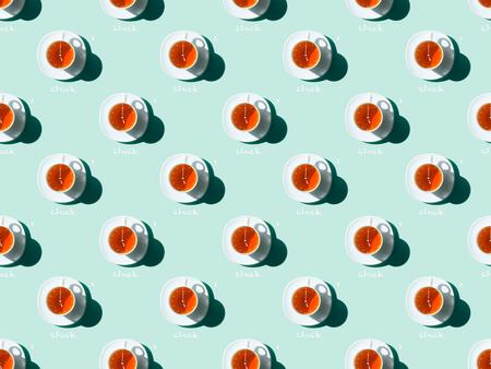 Foto de top view of tea time seamless pattern with tea cups and saucers on blue - Imagen libre de derechos