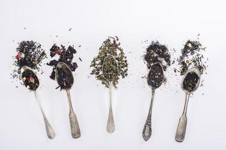 Foto de top view of assorted aromatic organic herbal tea in spoons on grey - Imagen libre de derechos