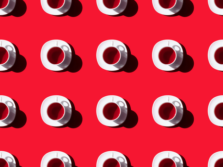 Foto de top view of tea time seamless pattern with tea cups and saucers on red - Imagen libre de derechos