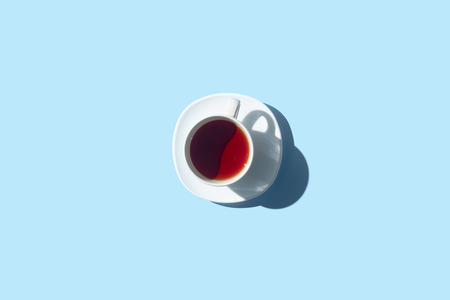 Foto de top view of cup of herbal tea isolated on blue - Imagen libre de derechos