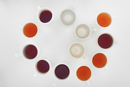 Foto de top view of empty cups and cups with healthy herbal tea on grey - Imagen libre de derechos
