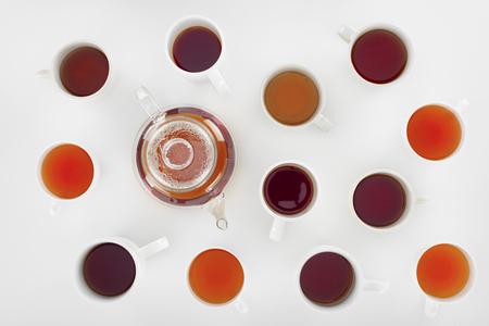 Foto de top view of assorted herbal tea in cups and teapot on grey - Imagen libre de derechos