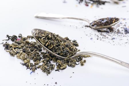 Foto de close-up view of healing herbal tea and spoons on grey - Imagen libre de derechos