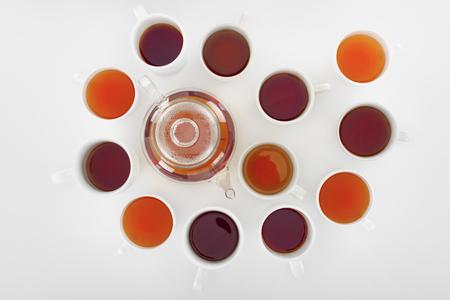 Foto de top view of various healthy herbal tea in cups and teapot on grey - Imagen libre de derechos