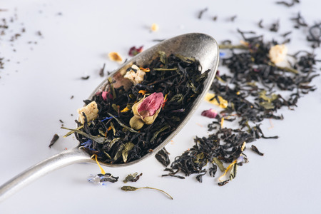 Foto de close-up view of healthy herbal tea in spoon on grey - Imagen libre de derechos